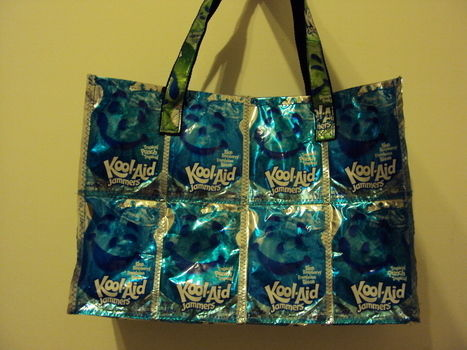 Re-use these drink pouches and make a fun bag! .  Make a recycled tote in under 150 minutes by sewing with strap and juice pouches. Creation posted by Joanne N. Difficulty: Easy. Cost: Cheap.