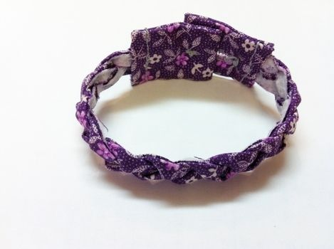 Messing around with scraps .  Make a braided fabric bracelet in under 60 minutes by sewing with fabric, sewing machine, and buttons. Inspired by clothes & accessories. Creation posted by Pam. Difficulty: 3/5. Cost: No cost.