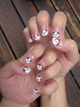 Cute Panda Nails .  Paint an animal nail in under 60 minutes by drawing, nail painting, decorating, and nail painting with nail polish, toothpick, and dotting tool. Inspired by pandas, pandas, and bows. Creation posted by Julia L. Difficulty: Easy. Cost: Cheap.