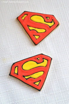 Superman sugar cookies decorated with royal icing .  Free tutorial with pictures on how to decorate a character cookie in under 40 minutes by cooking, baking, and decorating food with royal icing, gel food coloring, and cookie dough. Recipe posted by Michele C. Difficulty: Easy. Cost: Cheap. Steps: 4