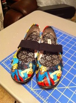 Modify an old pair of shoes with fabric for something new and fun! .  Make a pair of decoupage shoes by embellishing and decoupaging with fabric, decoupage glue, and shoes. Inspired by costumes & cosplay, clothes & accessories, and super hero. Creation posted by Phedre. Difficulty: 3/5. Cost: Absolutley free.