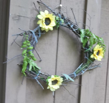 Easy to make wreathe I put outside.  .  Make a floral wreath in under 30 minutes by decorating and gardening with wire, wire cutters, and flowers. Inspired by flowers. Creation posted by chibimaru. Difficulty: Easy. Cost: No cost.
