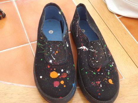 Colourful easy creation .  Free tutorial with pictures on how to paint a pair of paint splatter shoes in under 45 minutes by decorating with paint brush and shoes. Inspired by clothes & accessories. How To posted by claycupcakes. Difficulty: Easy. Cost: 3/5. Steps: 6