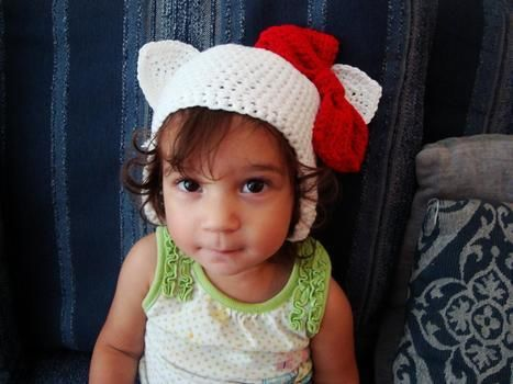 Cute as a button! .  Make an animal hat in under 90 minutes by yarncrafting and crocheting with yarn, crochet hook, and cotton yarn. Inspired by hello kitty, cats, and kawaii. Creation posted by gypsie_jay. Difficulty: Simple. Cost: Cheap.