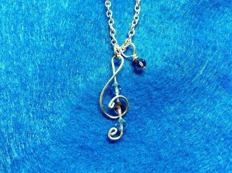 Keep a song in your heart <3 .  Make a wire pendant in under 30 minutes by jewelrymaking with wire, glass beads, and clasps. Inspired by music & bands and clothes & accessories. Creation posted by Pam. Difficulty: Simple. Cost: Cheap.