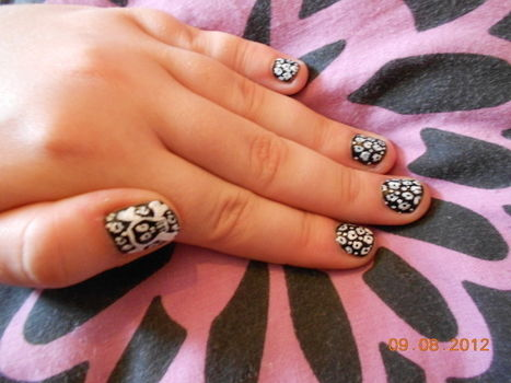 Rock Chic Supreme!! .  Free tutorial with pictures on how to paint an animal nail in under 40 minutes by nail painting and nail painting with nail polish, nail polish, and pins. Inspired by halloween, cats, and gothic. How To posted by Rachael T. Difficulty: 3/5. Cost: No cost. Steps: 1