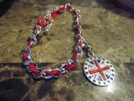For the Olympics .  Make a chain bracelet in under 20 minutes by not sewing with ribbon, charms, and jewelry chain. Inspired by olympics, clothes & accessories, and liberty london. Creation posted by Sporky McDorky. Difficulty: Easy. Cost: No cost.