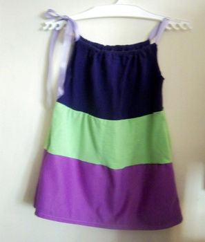 Refashion 3 T-shirts into a cute summer dress .  Sew a t-shirt dress in under 120 minutes by sewing with scissors, thread, and sewing machine. Creation posted by KMOM14. Difficulty: Easy. Cost: Absolutley free.