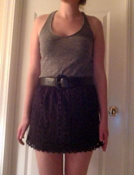 Instantly turn an old out of style shirt into a cute skirt .  Free tutorial with pictures on how to recycle a t-shirt skirt in under 5 minutes by not sewing with shirt and belt. Inspired by clothes & accessories. How To posted by Alexis K. Difficulty: Easy. Cost: No cost. Steps: 4