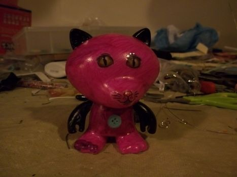 Meow! .  Sculpt a clay cat in under 30 minutes by decorating and embellishing with permanent marker, stickers, and figure. Inspired by cats. Creation posted by Ashley P. Difficulty: Easy. Cost: Absolutley free.