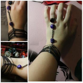A ring that connects to your bracelet! .  Make a hand bracelet in under 30 minutes by jewelrymaking and chainmailing with chain, pendant(s), and ring base. Inspired by gothic, vintage & retro, and clothes & accessories. Creation posted by Mousey. Difficulty: Easy. Cost: No cost.