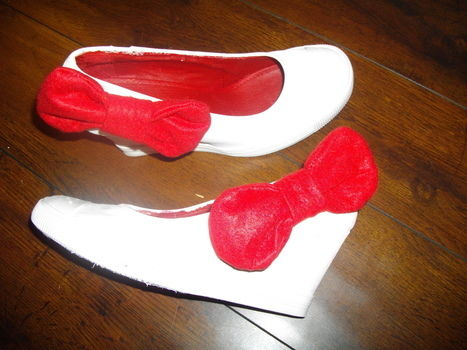 Kitty bow wedges  .  Embellish a pair of bow shoes in under 60 minutes using felt, acrylic paint, and fabric paint. Inspired by hello kitty and bows. Creation posted by Peaceyzz. Difficulty: Simple. Cost: Cheap.
