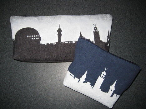 City skyline pencil/make-up case .  Make a pouch, purse or wallet in under 60 minutes by stencilling, sewing, and decorating with fabric, fabric, and paint brush. Creation posted by Julia L. Difficulty: Easy. Cost: 3/5.