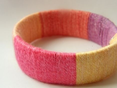 More color in your life! .  Make a wrapped bangle in under 60 minutes using scissors, wool, and patience. Creation posted by Anna H. Difficulty: Easy. Cost: No cost.