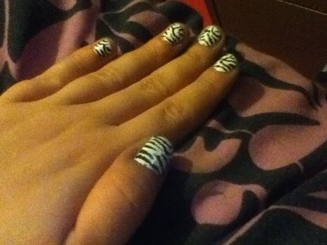 Quick and very pretty .  Paint an animal print nail in under 20 minutes by nail painting and nail painting with nail polish and nail polish. Inspired by zebra print and zebra print. Creation posted by Rachael T. Difficulty: Easy. Cost: Absolutley free.