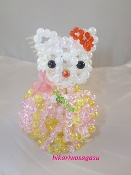 Adorable and elegant Hello Kitty in Kimono .  Make a beaded animal in under 180 minutes by beading and beading Inspired by japanese, hello kitty, and cats. Creation posted by dory.eng. Difficulty: Easy. Cost: 3/5.