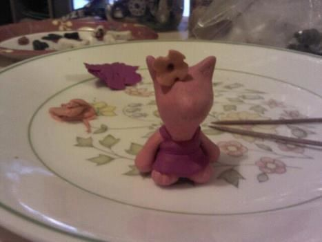 Made for a friends birthday. .  Sculpt a clay cat by molding with toothpick, glitter glue, and sculpey clay. Inspired by kawaii. Creation posted by Jeremy C. Difficulty: 4/5. Cost: Cheap.