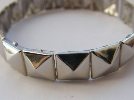 Sooo easy! .  Free tutorial with pictures on how to make a cuff in under 20 minutes by studding, jewelrymaking, and studding with scissors, studs, and plastic bottle. Inspired by gothic. How To posted by Anna H. Difficulty: Easy. Cost: No cost. Steps: 2