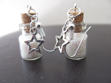 Little bottles of stardust to brighten up your day =) .  Free tutorial with pictures on how to make a pair of vial earrings in under 60 minutes by jewelrymaking with hot glue gun, jump rings, and earring hooks. Inspired by crafts, stars, and clothes & accessories. How To posted by LollypopLoz. Difficulty: Simple. Cost: Cheap. Steps: 10