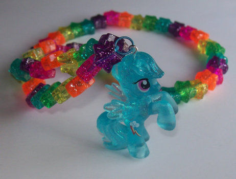 A whole herd of cute! .  Make a toy necklace in under 30 minutes by jewelrymaking with beads, chain, and charms. Inspired by cartoons, costumes & cosplay, and vintage & retro. Creation posted by PixiePlight. Difficulty: Easy. Cost: Cheap.
