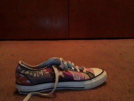 A fun way to make a pair of sneakers into a piece of art that you can wear .  Make a pair of embellished shoes by drawing and studding with sharpie and sharpie. Creation posted by Jessica O. Difficulty: 3/5. Cost: Absolutley free.