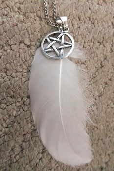 Elegant pagan necklace .  Make a feather necklace in under 10 minutes using feather, necklace chain, and pendant. Inspired by pentacle. Creation posted by JossieAyame. Difficulty: Easy. Cost: Absolutley free.