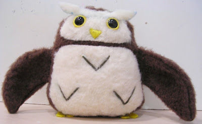 Make your own huggable & cuddly pigmy owl! .  Free tutorial with pictures on how to make a bird plushie in under 120 minutes by needleworking, embroidering, and sewing with fabric, pattern, and scissors. Inspired by creatures, owls, and owls. How To posted by jwodesigns. Difficulty: 3/5. Cost: Cheap. Steps: 9
