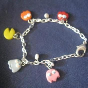 Charm bracelet themed after the popular game .  Free tutorial with pictures on how to sculpt a clay character bracelet in 1 step by creating, applying makeup, making beauty products, jewelrymaking, potting, and resinworking with polymer clay and chain. Inspired by pac-man, gothic, and costumes & cosplay. How To posted by .  in the Jewelry section Difficulty: 3/5. Cost: No cost.