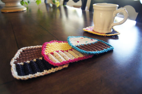 Keep your coffee table safe and cute with this free crochet cupcake coasters! .  Free tutorial with pictures on how to stitch a knit or crochet coaster in under 30 minutes by crocheting with crochet hook, worsted weight yarn, and yarn needle. Inspired by cupcakes. How To posted by louis.mensinger. Difficulty: Easy. Cost: Absolutley free. Steps: 6