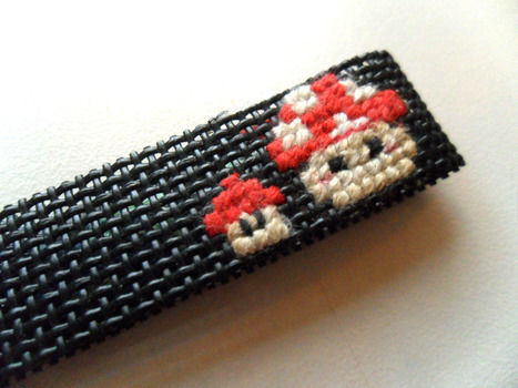 A simple and cute cross-stitching project .  Make a stitched charm by constructing, cross stitching, and cross stitching with thread, paper, and key ring. Inspired by japanese, anime & manga, and cartoons. Creation posted by angelichigo. Difficulty: Easy. Cost: Absolutley free.