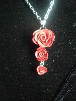 Layerd roses on a silver chain .  Free tutorial with pictures on how to make a floral pendant in under 30 minutes by creating, applying makeup, jewelrymaking, and potting with polymer clay and jewelry supplies. Inspired by gothic, vintage & retro, and flowers. How To posted by . Difficulty: 5/5. Cost: 4/5. Steps: 1