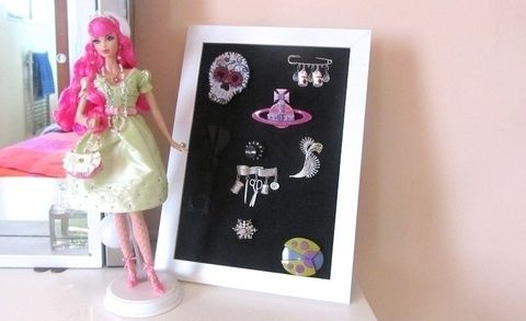 Make a super simple display for your brooches! .  Free tutorial with pictures on how to make a jewelry frame in under 2 minutes by constructing with felt, glue, and frame. How To posted by Cat Morley. Difficulty: Easy. Cost: Absolutley free. Steps: 5