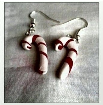 Candy canes on your ear .  Make a pair of clay earring in under 30 minutes by jewelrymaking and  with polymer clay, polymer clay, and earring hooks. Inspired by christmas and food. Creation posted by MischievousRaven. Difficulty: Easy. Cost: Absolutley free.