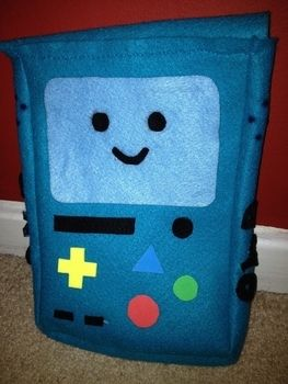 Who wants to play video games? A little smiley felt bag for nicknacks and stuff! .  Make a gadget plushie by sewing with scissors, hot glue gun, and pencil. Inspired by kawaii and adventure time. Creation posted by happymrschicken. Difficulty: Simple. Cost: Cheap.