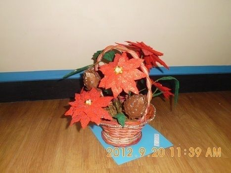 Poinsettias - flower arrangement .  Make an object plushie in under 120 minutes by decorating, wireworking, felting, not sewing, and sewing with wire, hot glue gun sticks, and basket. Inspired by flowers and flowers. Creation posted by blue. Difficulty: Easy. Cost: 3/5.