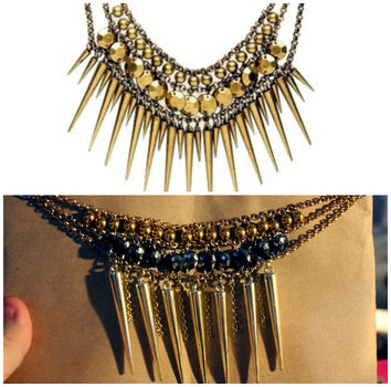 Feels a little Egyptian-ey. Don't Buy - DIY! .  Make a spike necklace in under 30 minutes using beads, chain, and spikes. Inspired by halloween, gothic, and costumes & cosplay. Creation posted by Mousey. Difficulty: 3/5. Cost: No cost.
