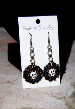 Lightweight, Round Lace + Felt Flower with Beads & Mini Sugar Skull sewed on it. .  Make a pair of lace earrings in under 20 minutes by beading, jewelrymaking, chainmailing, needleworking, sewing, and felting with felt, jump rings, and seed beads. Inspired by crafts, halloween, and gothic. Creation posted by CazSteele. Difficulty: Simple. Cost: Cheap.