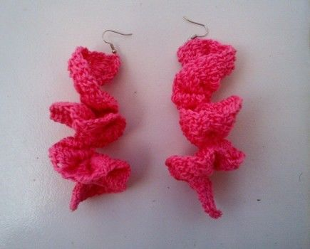 Pink crochet earrings, .  Stitch a pair of knit or crochet earrings in under 60 minutes by crocheting with crochet hook, earring hooks, and crochet thread. Creation posted by Kenisha y. Difficulty: Easy. Cost: Cheap.