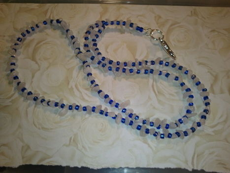 Beautiful White & Blue  .  Free tutorial with pictures on how to make a single-strand bead necklace in under 60 minutes by beading with crimp beads, wire, and crimping pliers. Inspired by clothes & accessories. How To posted by nicole.johnson.520. Difficulty: Simple. Cost: Cheap. Steps: 1
