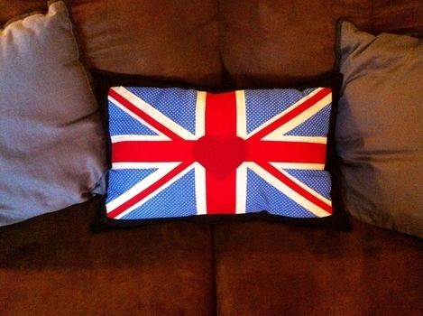 Cute new pillow .  Make a stitched cushion in under 120 minutes by sewing with fabric, sewing machine, and stuffing. Inspired by british and union jack. Creation posted by Princess Pam-attitude . Difficulty: 3/5. Cost: Absolutley free.