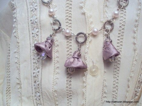 Wedding necklace with faux pearls, fabric bell flowers and crystal beads .  Free tutorial with pictures on how to make a tassel necklace in 9 steps by jewelrymaking with fabric, jump rings, and jump rings. Inspired by weddings and clothes & accessories. How To posted by Rozantia P. Difficulty: Easy. Cost: 3/5.