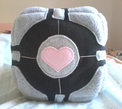 The Enrichment Center reminds you that the Weighted Companion Cube will never threaten to stab you and, in fact, cannot speak.  .  Make a cube plushie by sewing with stuffing, polyester stuffing, and sewing thread. Inspired by creatures, costumes & cosplay, and kawaii. Creation posted by Conn. Difficulty: 3/5. Cost: Cheap.
