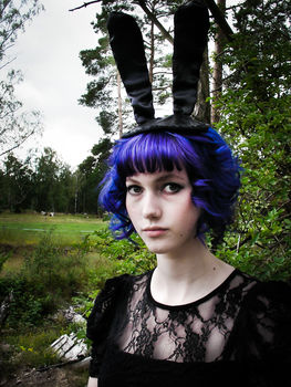A classy bunny hat for people with heads to put it on. .  Make an animal hat by constructing and sewing with fabric, scissors, and sewing machine. Inspired by rabbits, costumes & cosplay, and clothes & accessories. Creation posted by EmmaThePrincess. Difficulty: 3/5. Cost: Cheap.