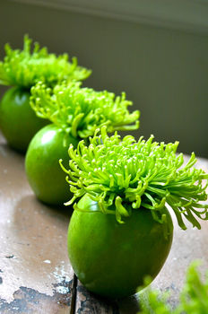 """Create an explosion of color on your dining table with this fun """"apple bomb"""" centerpiece. .  Free tutorial with pictures on how to make a vase, pot or planter in 1 step by decorating with apples, apple corer, and spider mums. How To posted by Camilla F. Difficulty: Easy. Cost: 3/5."""