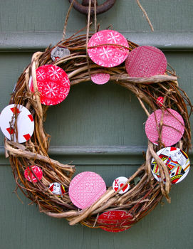 Cut the deck to deck your door with this wreath made from old playing cards! .  Free tutorial with pictures on how to make a branch & twig wreath in 1 step by decorating and papercrafting with hole punch, playing card, and wreath form. How To posted by Camilla F. Difficulty: Simple. Cost: Cheap.
