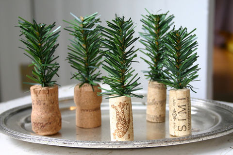 These DIY tiny Christmas trees look great on a tray, mantel or as placecard holders.. .  Free tutorial with pictures on how to create art / a model in 3 steps by decorating with wire cutters, awl, and cork. How To posted by Camilla F. Difficulty: Easy. Cost: Cheap.