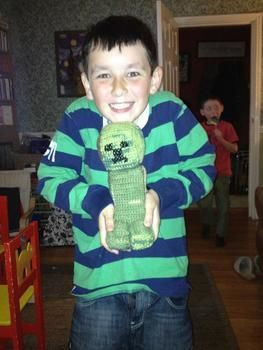 Crochet a super creeper from Minecraft!! .  Sew a computer game plushie by cross stitching, embroidering, and crocheting with crochet hook, wool, and toy filling. Inspired by creatures and minecraft. Creation posted by Lane L. Difficulty: 3/5. Cost: Cheap.