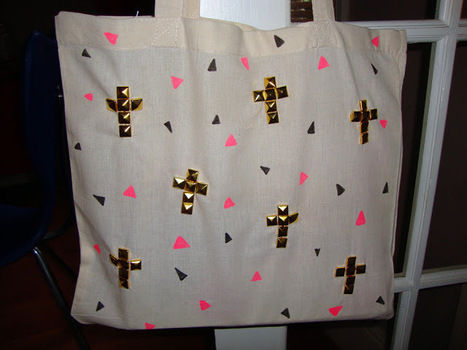 Much cooler than a bag for life. .  Free tutorial with pictures on how to make an embellished tote in under 60 minutes by embellishing and studding with fabric pen, tote bag, and pyramid studs. How To posted by thegluegungirl. Difficulty: Simple. Cost: Cheap. Steps: 9