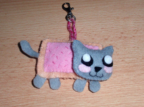 Nyan Cat Felt Plushie / Keychain  .  Make a cat plushie in under 120 minutes by braiding and sewing with felt, felt, and felt. Inspired by nyan cat and nyan cat. Creation posted by ZombieUnicorn. Difficulty: 3/5. Cost: 3/5.