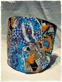 This is the 2nd part of the tutorial and mainly about how I have put the peacock on the cuff, the first part is about how I made the cuffs. .  Free tutorial with pictures on how to make a cuff earring in under 60 minutes by jewelrymaking, papercrafting, and collage with paper, glue, and cuff. Inspired by vintage & retro and peacock. How To posted by Artistically. Difficulty: 3/5. Cost: Absolutley free. Steps: 13
